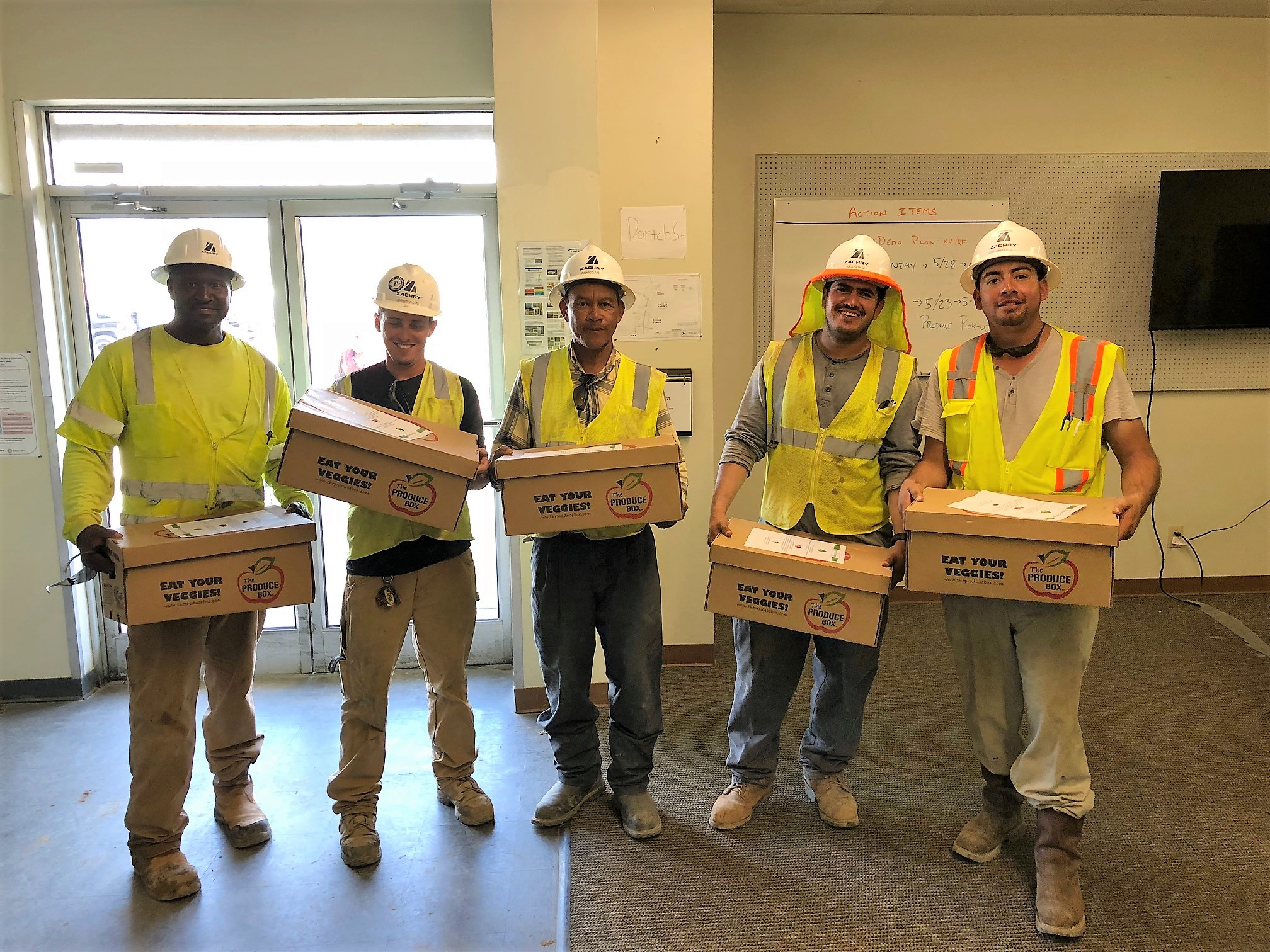 Workers receiving their boxes for their corporate wellness initiative