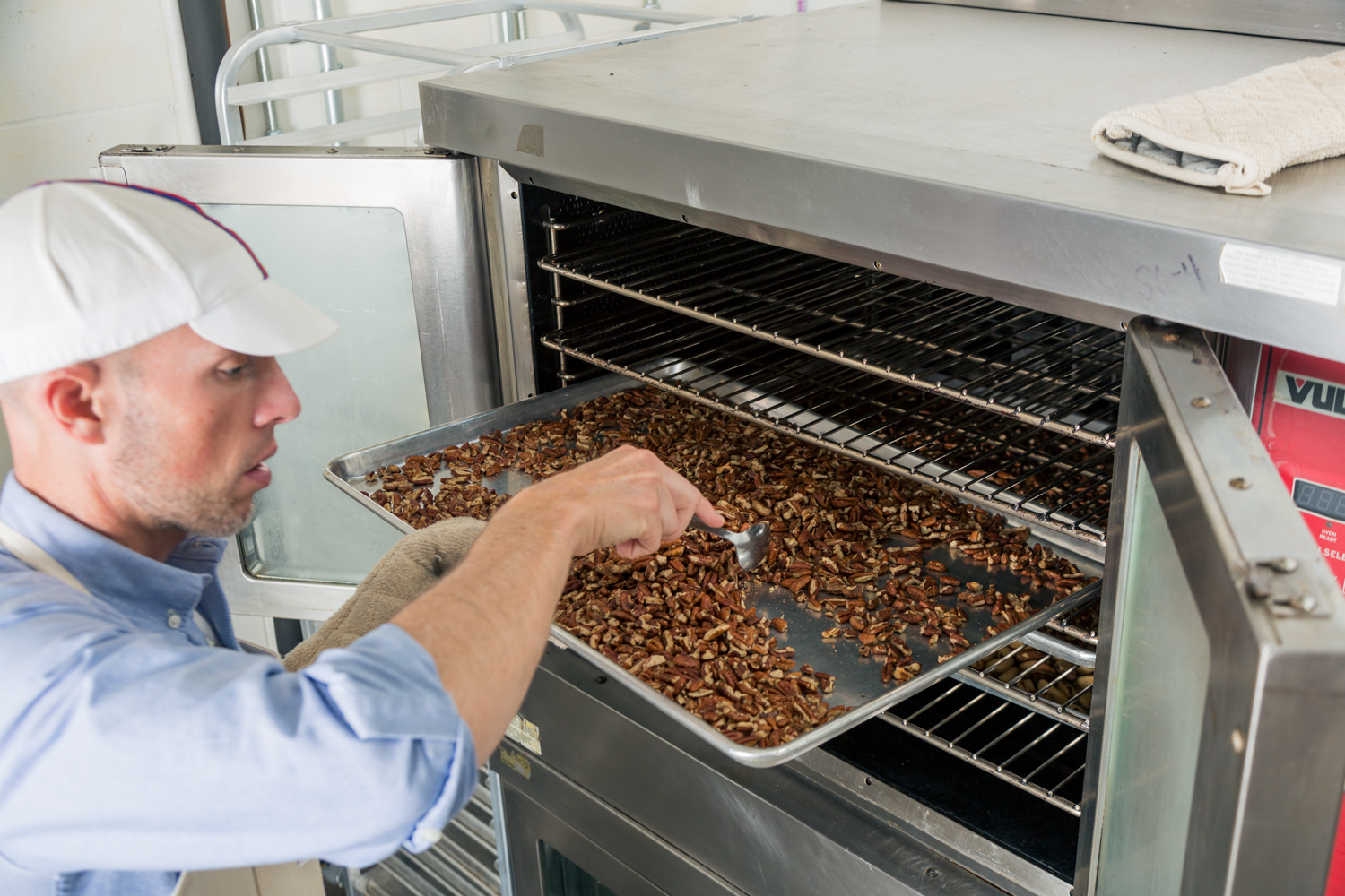 Mark Overbay checks on a batch of roasted nuts. (Photo courtesy of Big Spoon Roasters)